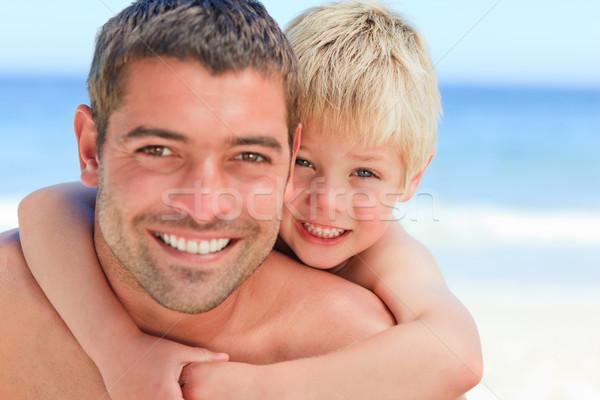 笑みを浮かべて 父 ピギーバック ビーチ 笑顔 ストックフォト © wavebreak_media
