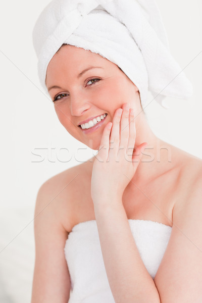 Good looking young woman wearing a towel against a white background Stock photo © wavebreak_media