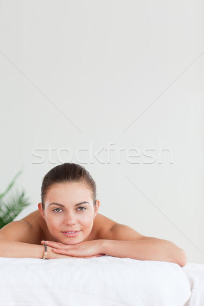 Portrait of a brunette lying on a massage table Stock photo © wavebreak_media