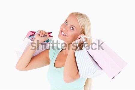 Stock fotó: Boldog · nő · tart · bevásárlótáskák · stúdió · mosoly