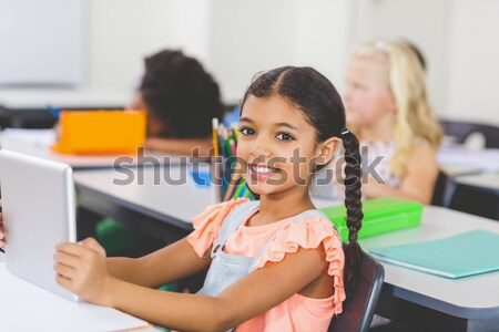 Stock photo: Portrait of a cute student being distracted in an amphitheater