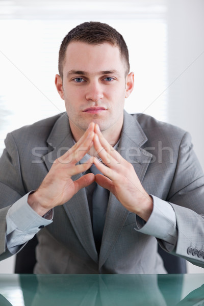 Close up of young business sitting behind a table Stock photo © wavebreak_media