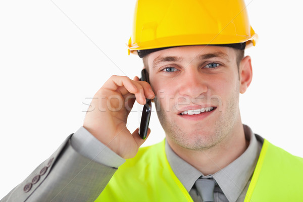 Close up of a builder making a phone call against a white background Stock photo © wavebreak_media