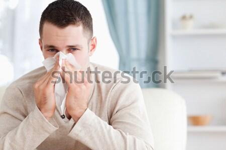 Man blazen neus woonkamer gezondheid sofa ziek Stockfoto © wavebreak_media