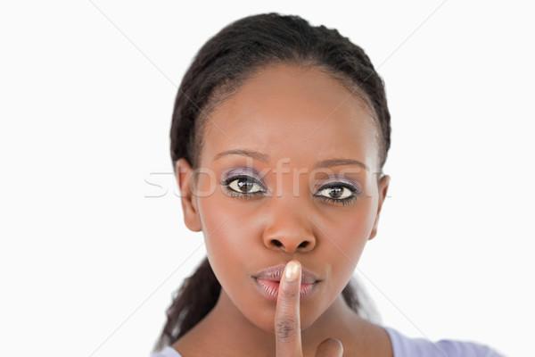 Jonge vrouw veeleisende stilte witte ruimte Stockfoto © wavebreak_media