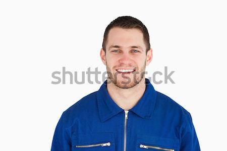 улыбаясь молодые синих воротничков работник белый улыбка Сток-фото © wavebreak_media