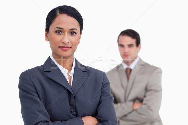 Elarusítónő keresztbe tett kar kolléga mögött fehér férfi Stock fotó © wavebreak_media