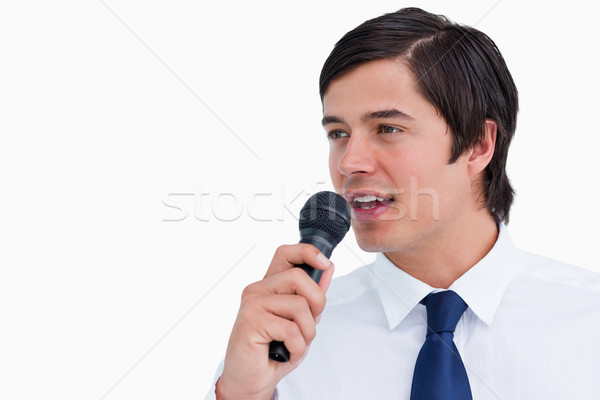 Close up side view of young tradesman with microphone against a white background Stock photo © wavebreak_media