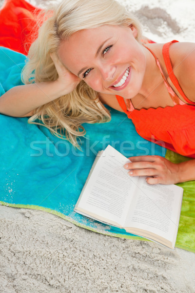 Overhead view of a young woman looking at the camera while lying down Stock photo © wavebreak_media