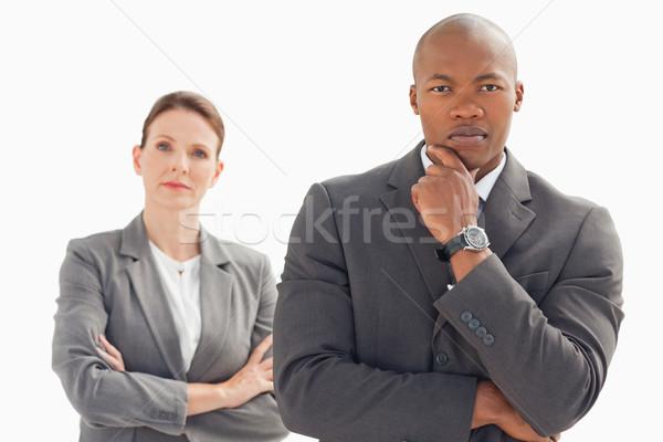 серьезный деловые люди глядя камеры рук заседание Сток-фото © wavebreak_media
