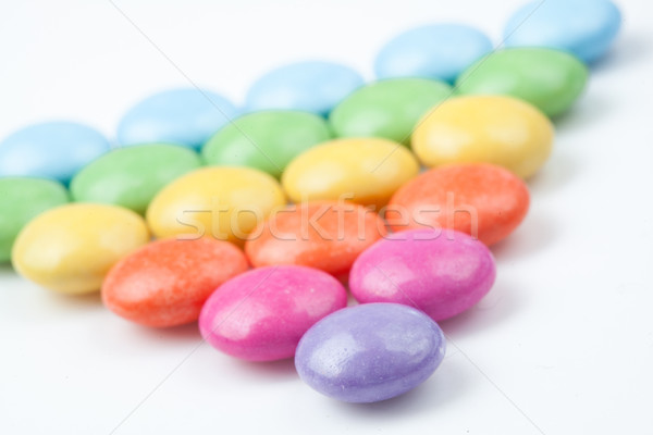 Triangle of candies against a white background Stock photo © wavebreak_media