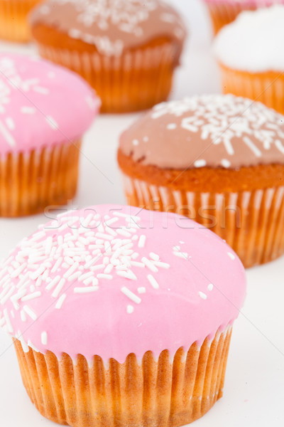 Close up of many muffins with icing sugar against a white background Stock photo © wavebreak_media