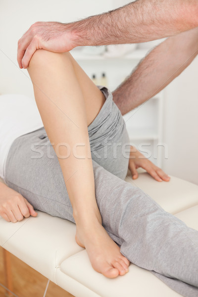 Physiotherapist crossing the leg of his patient in a physio room Stock photo © wavebreak_media