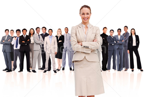 Businesswoman standing up in foreground against a white background Stock photo © wavebreak_media
