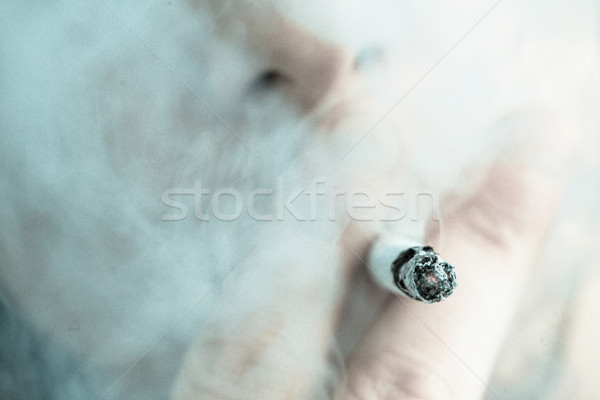 Man smoking out himself with a cigarette Stock photo © wavebreak_media