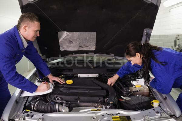 Mechanics checking a car engine in a garage Stock photo © wavebreak_media