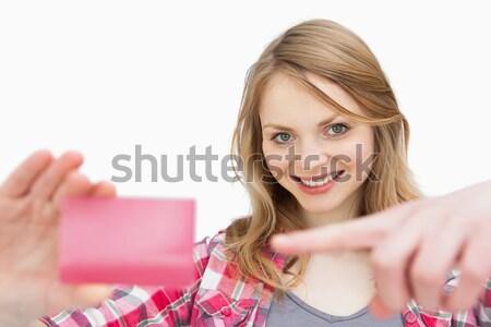 Mujer lealtad tarjeta mirando cámara Foto stock © wavebreak_media