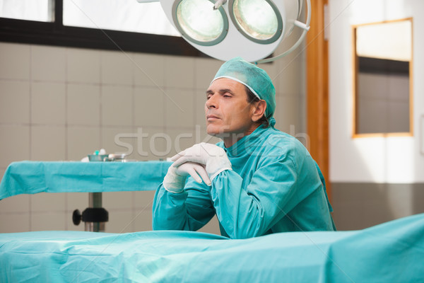Reflective surgeon sitting in a operating theater in a hospital Stock photo © wavebreak_media