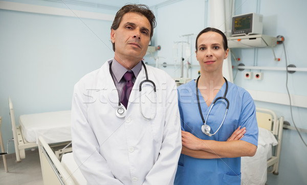 Doctor and nurse as a team in hospital bedroom Stock photo © wavebreak_media