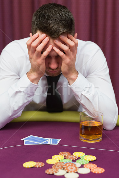 Man leaning on poker table looking worried in casino Stock photo © wavebreak_media