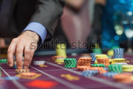Homme casino roulette table argent Photo stock © wavebreak_media