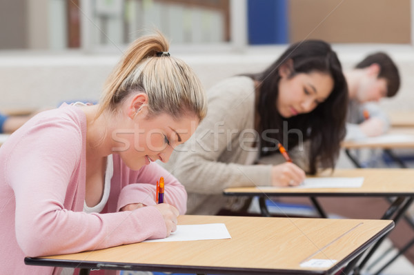 Students writing in the exam hall in college Stock photo © wavebreak_media