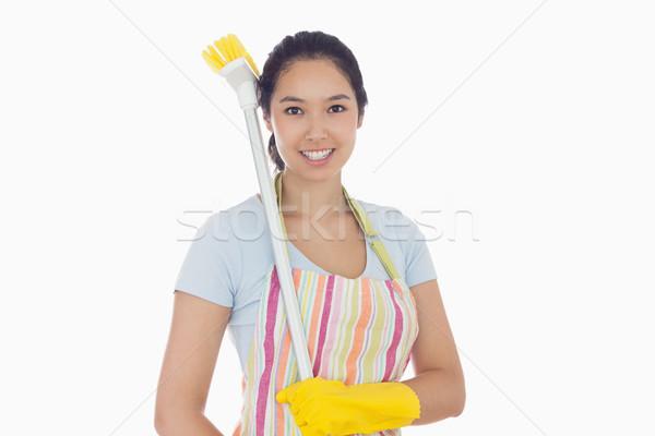 Happy woman in gloves with broom on her shoulder  Stock photo © wavebreak_media
