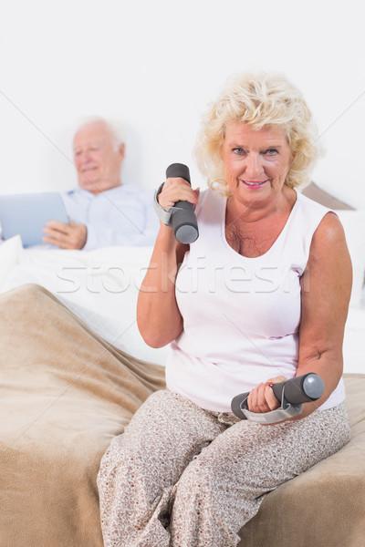 Elderly woman lifting dumbbells Stock photo © wavebreak_media