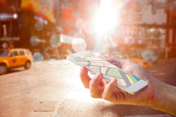 Composite image of man using map app on phone Stock photo © wavebreak_media