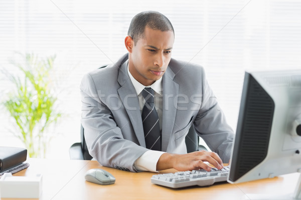 Concentrated businessman using computer at office Stock photo © wavebreak_media