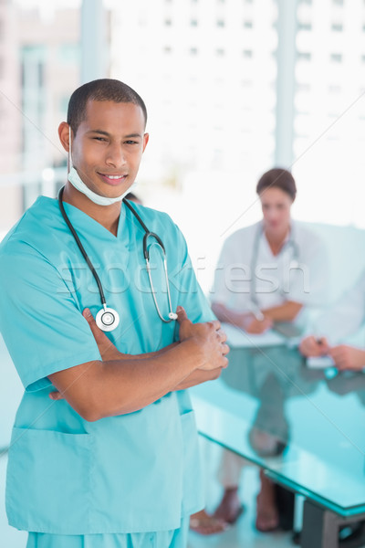 Surgeon standing with group around table in hospital Stock photo © wavebreak_media