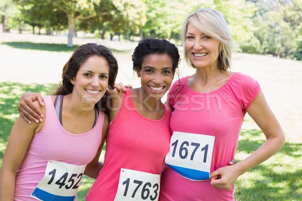 Happy women participating in breast cancer marathon  Stock photo © wavebreak_media