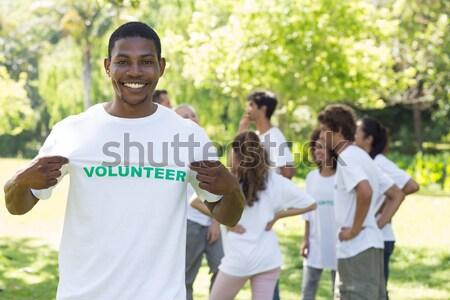 Volunteer pointing at tshirt in park Stock photo © wavebreak_media