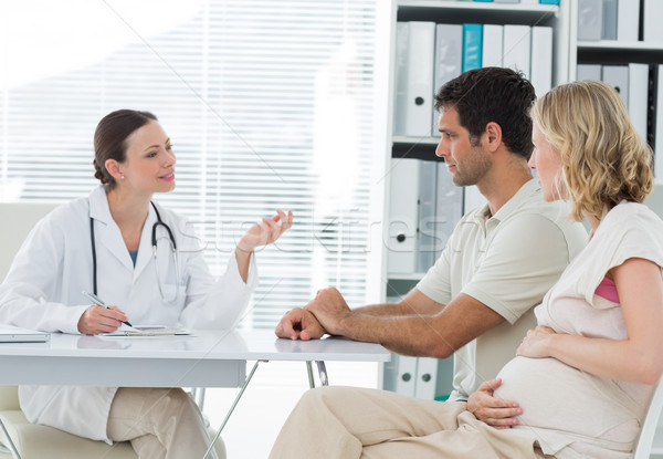 Dynaecologist discussing with expectant couple Stock photo © wavebreak_media