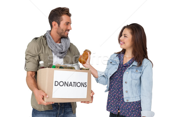 Smiling young couple with donation box Stock photo © wavebreak_media