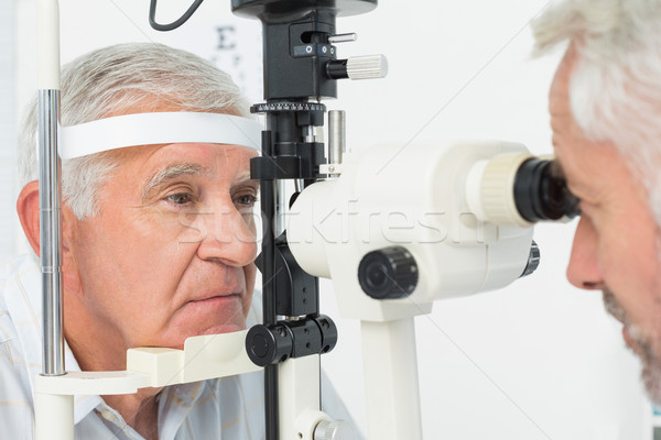 Optometrist doing sight testing for senior patient Stock photo © wavebreak_media