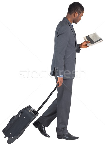Young businessman pulling his suitcase Stock photo © wavebreak_media