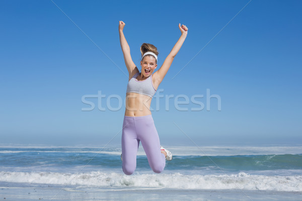 Sporty happy blonde jumping on the beach  Stock photo © wavebreak_media