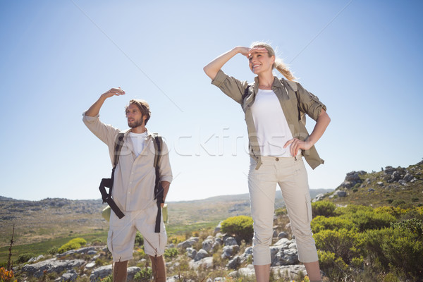 Kirándulás pár áll hegy terep néz Stock fotó © wavebreak_media