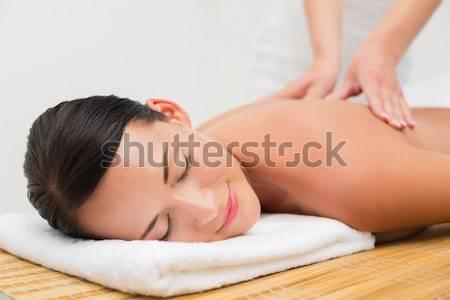 Stock photo: Beautiful brunette enjoying a back massage