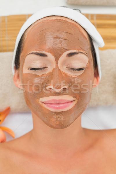 Sorridente morena lama tratamento mulher Foto stock © wavebreak_media