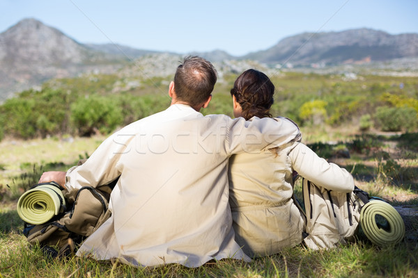 Hiking couple sitting and admiring the scenery Stock photo © wavebreak_media