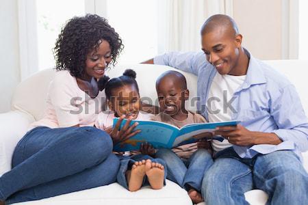 Boldog család kanapé olvas mesekönyv otthon nappali Stock fotó © wavebreak_media