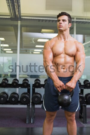 Mid section of shirtless muscular man exercising with dumbbell Stock photo © wavebreak_media