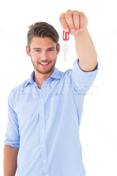 Handsome young man showing new house key Stock photo © wavebreak_media