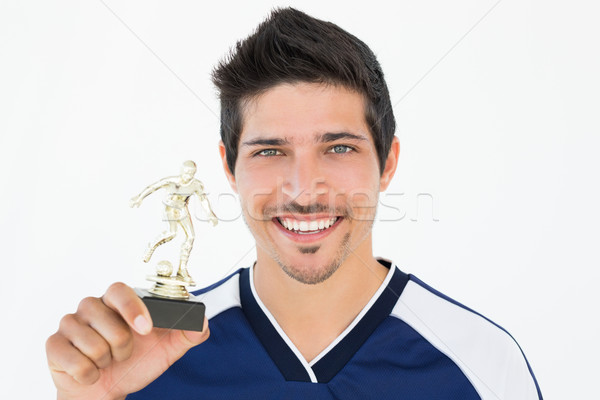 Football player holding winners trophy Stock photo © wavebreak_media