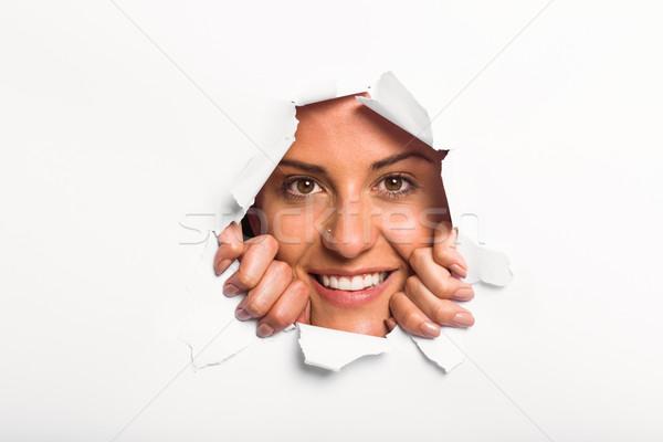 глядя бумаги женщины улыбаясь дыра Сток-фото © wavebreak_media