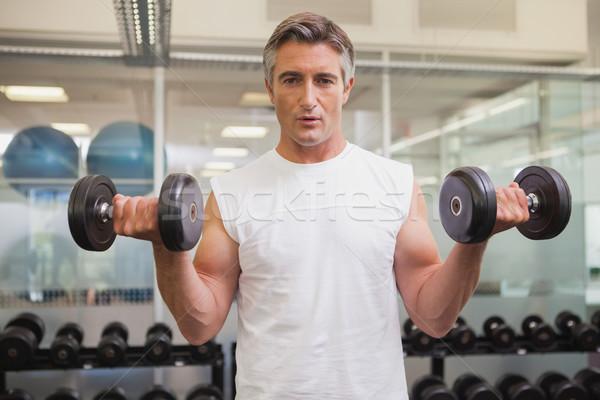 Encajar hombre pesado negro pesas Foto stock © wavebreak_media