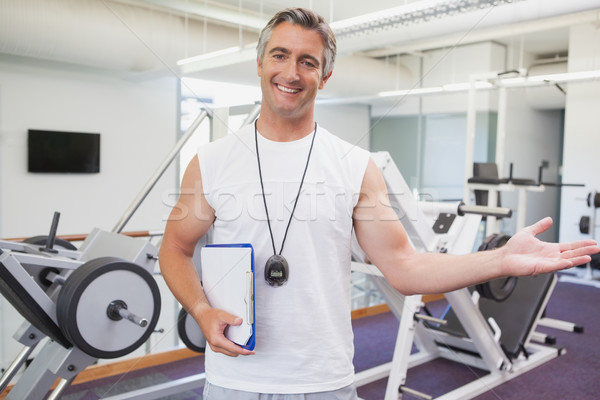 Fit personal trainer smiling at camera in fitness studio Stock photo © wavebreak_media