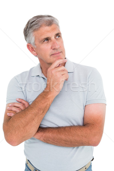 Casual man thinking with hand on chin Stock photo © wavebreak_media